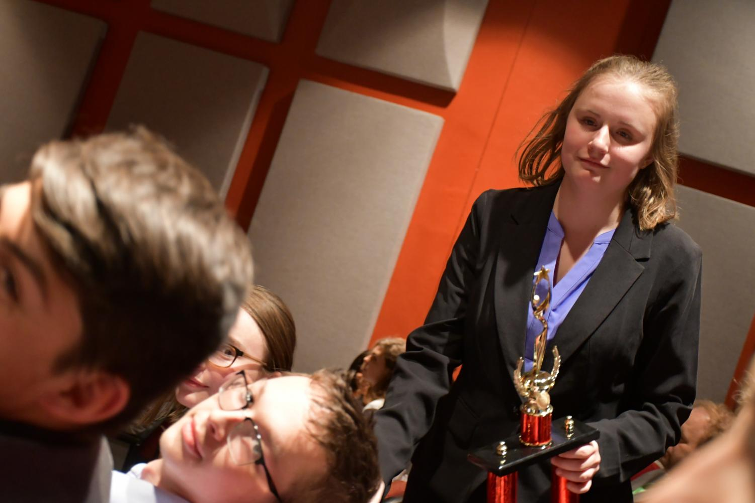 Boone forensics Junior captain Emma McGee (center) holds Boone's Dixie Heights tournament trophy