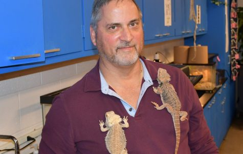 Science teacher Ray Kues allows his bearded dragons to cling to his shirt.