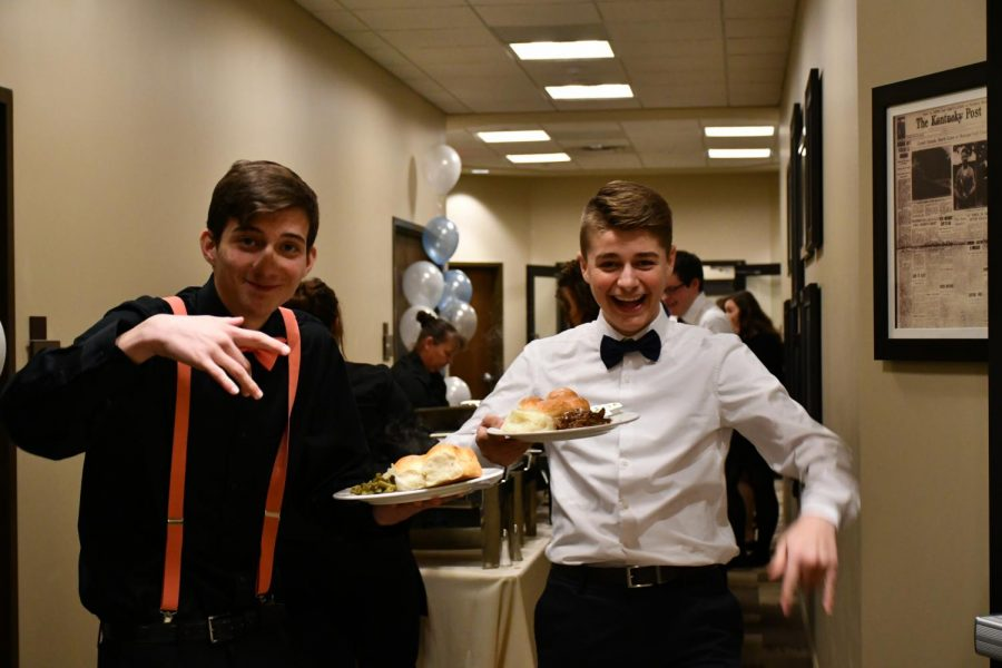 Seniors Dylan Gascon and Devin Schwabe pose with their meals at the Senior Dinner Dance on 1/26/19