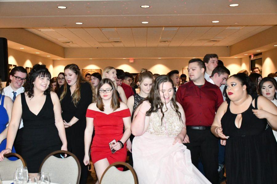 Various seniors dance the cha cha slide at the Senior Dinner Dance on 1/26/19