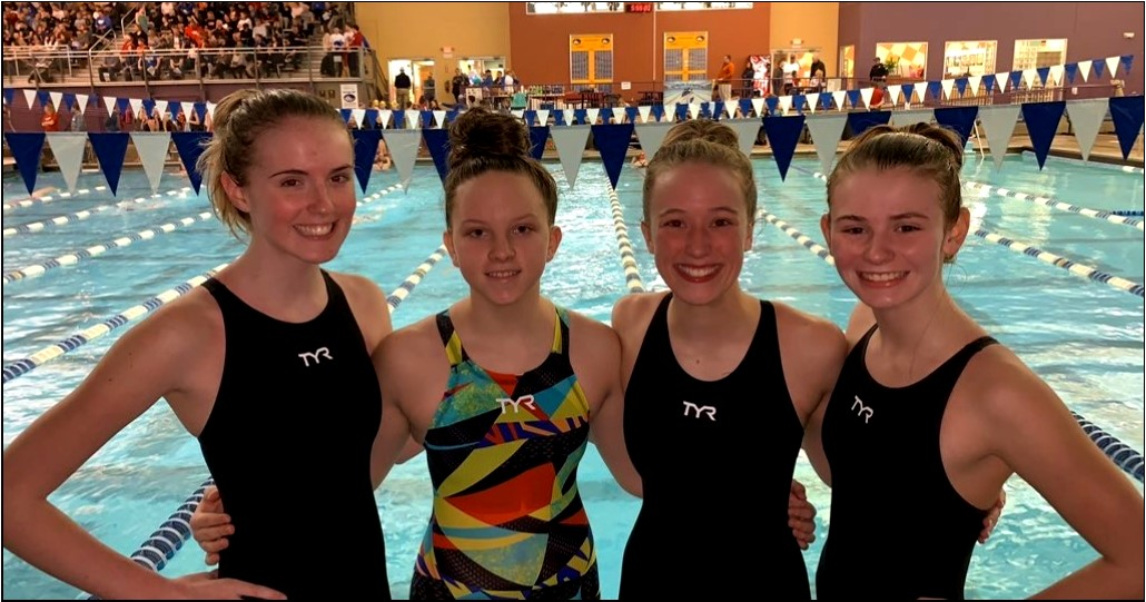 Boone's girls 400-yard freestyle relay—(PICTURED AT REGIONAL FINALS FROM LEFT TO RIGHT) sophomore Caitlin Bailey, freshman Sydney Whitford, junior Becca Mulroney and freshman Sophie Pile—dropped 15.3 seconds at regionals to  beat Cooper by a half second.