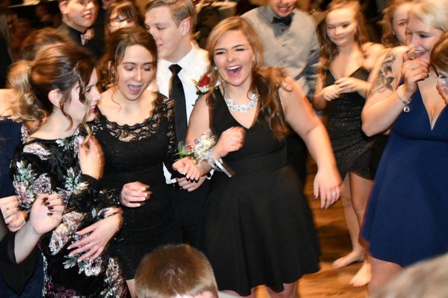 Senior Becca Schrieber dances with friends on the dance floor at the Senior Dinner Dance on 1/26/19