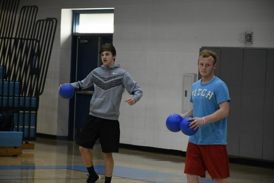 Seniors+Trevor+Miller+%28LEFT%29+and+Hunter+Freeman+compete+in+the+National+Honor+Society%E2%80%99s+annual+dodgeball+tournament+in+the+Boone+gym+on+March+22.+The+event+raised+money+for+the+organization.