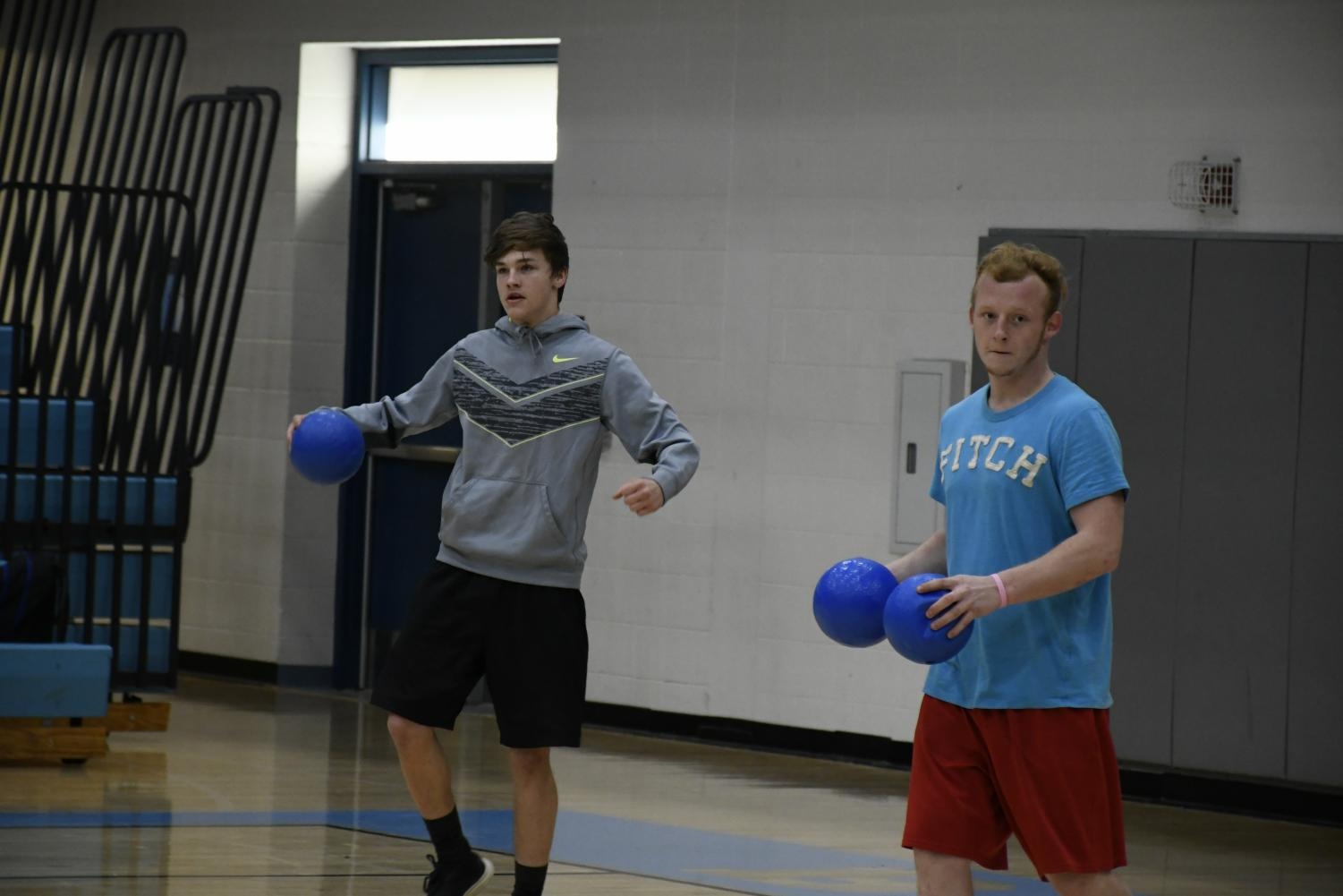 Seniors Trevor Miller (LEFT) and Hunter Freeman compete in the National Honor Society's annual dodgeball tournament in the Boone gym on March 22. The event raised money for the organization.