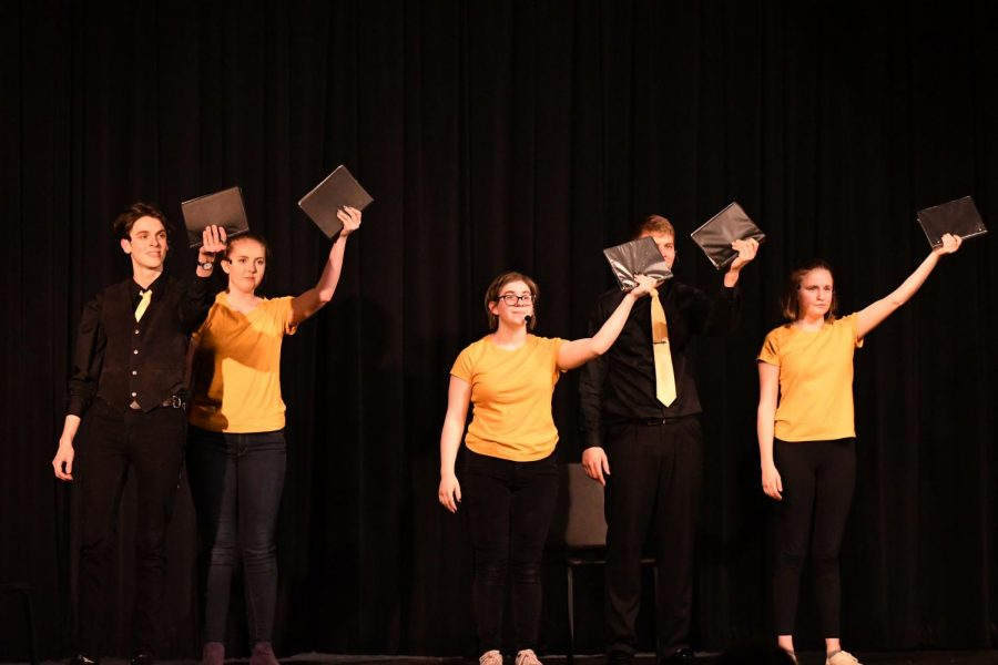 Junior Bryce Herzner, Junior Casey Beusterien, Senior Ally Fisher, Senior Chris Bonham, and Senior Emma McGee perform Little Miss Sunshine