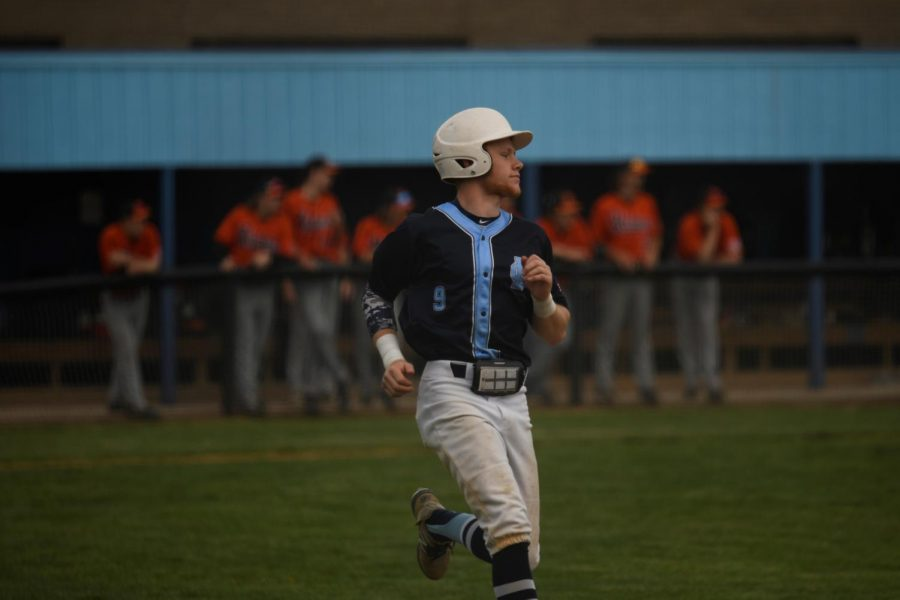 Senior pitcher/outfielder Zack Grau heads towards first base during Boone's home game against the Ryle Raiders on April 17. Grau hit a home run in the Rebels 9-4 loss.