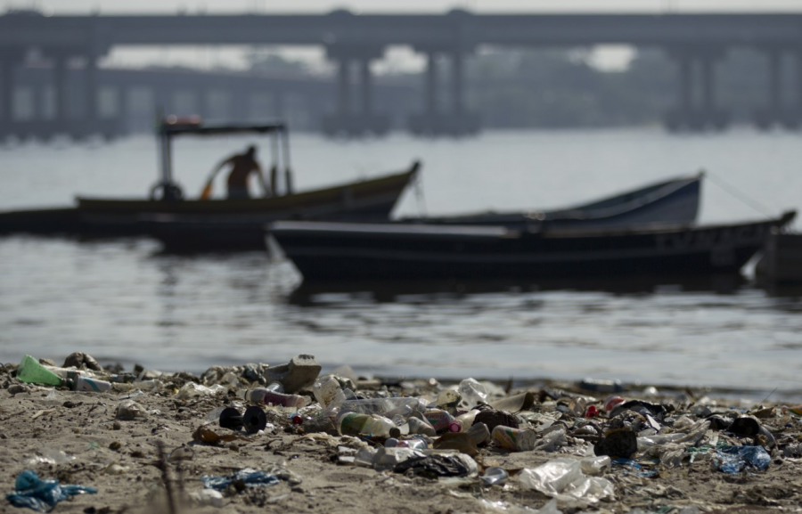 In+this+photo+taken+on+Friday%2C+June+15%2C+2012%2C+a+fisherman+takes+his+boat+onto+a+trash-ridden+beach+on+Guanabara+Bay+near+the+international+airport+in+Rio+de+Janeiro%2C+Brazil.+%0A
