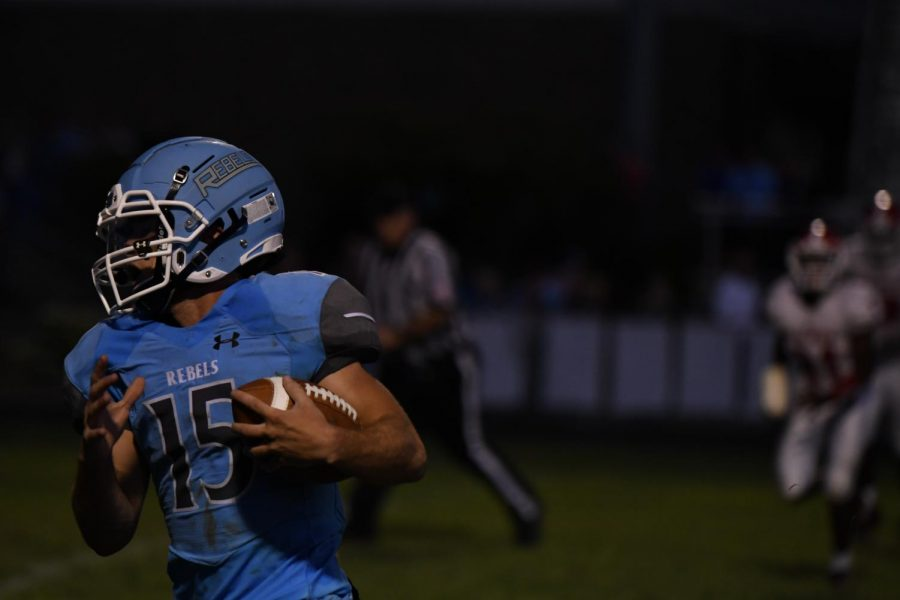 Boone+senior+Eli+Rossi+runs+with+the+ball+during+the+football+game+at+Boone+County+High+School+on+Aug.+23.
