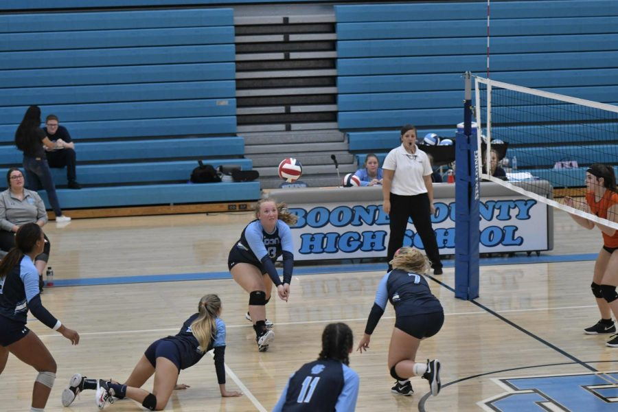 Boone+County+High+School+junior+Samantha+Hodge+hits+the+ball%2C+while+senior+Madison+Gilbert+prepares+to+hit+it%2C+during+the+volleyball+game+at+Boone+County+High+School+on+Sept.+19.+