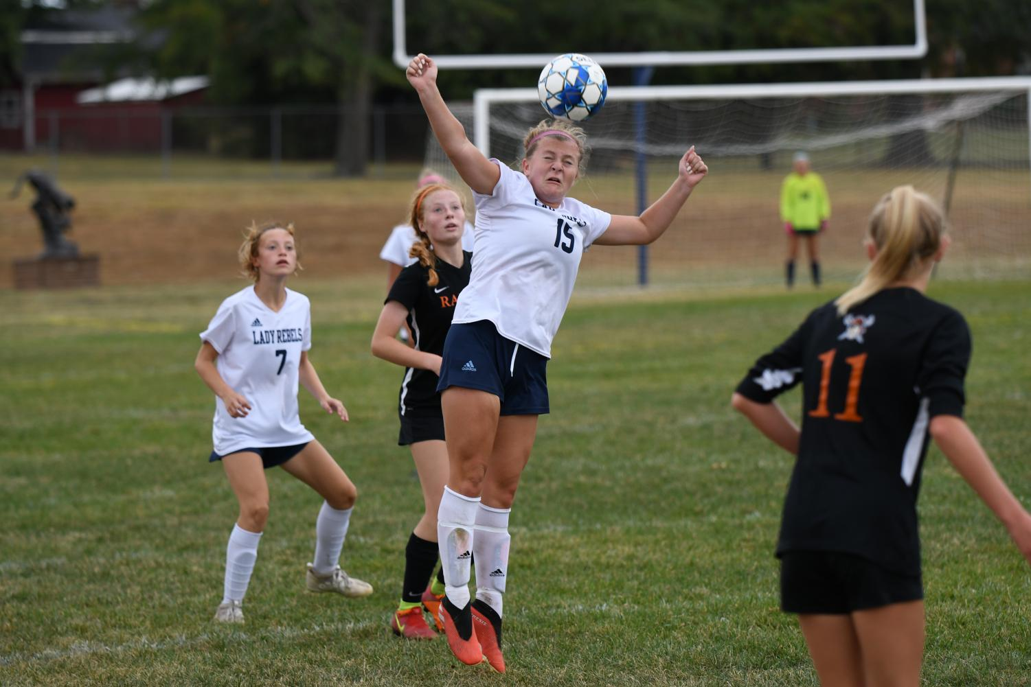 Junior Maddy Hobbs jumps up and hits the ball with her head, during the district soccer game at Conner high school on Oct. 6.