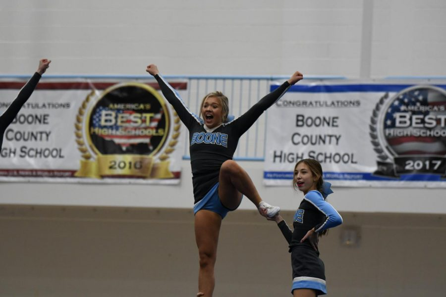 Senior Ali Schuster and sophomore Payeton Wright cheer from atop the build at the KHSAA Region 5 Championship at Boone County High School on Nov. 23.