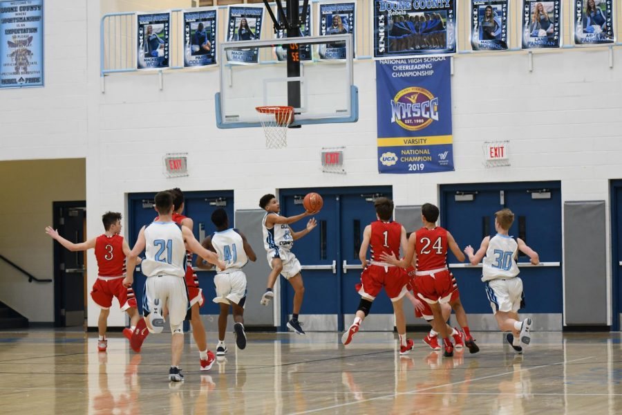 Junior+Marquis+Washington+goes+up+for+an+acrobatic+layup+during+a+junior+varsity+basketball+game+against+Beechwood+on+Dec.+3.