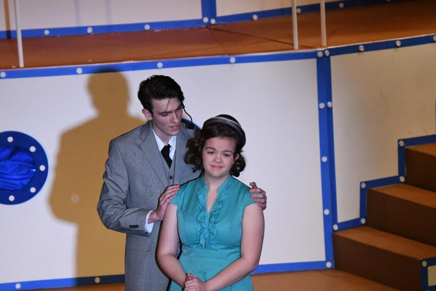 Billy+Crocker+%28senior+Bryce+Herzner%29+gently+embraces+Hope+Harcourt+%28senior+McKayla+major%29+during+a+performance+of+%22Anything+Goes%21%22+at+Boone+on+Dec.+6.