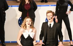 Senior Casey Beusterien (Reno Sweeney) and junior Robert Saner (Lord Evelyn Oakleigh) perform the final number during a performance of