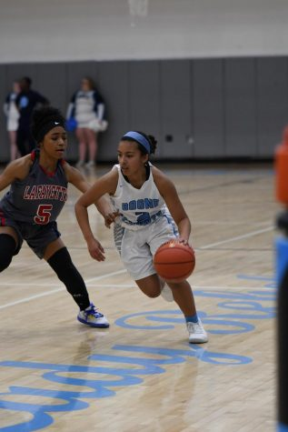 Senior Alissa Avila dribbles towards the basket during the girls basketball game against Lafayette on Dec. 12.