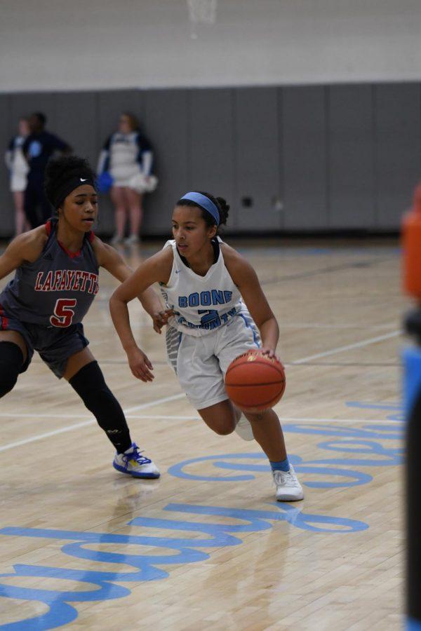 Senior Alissa Avila dribbles towards the basket during the girls basketball game against Lafayette on Dec. 12.