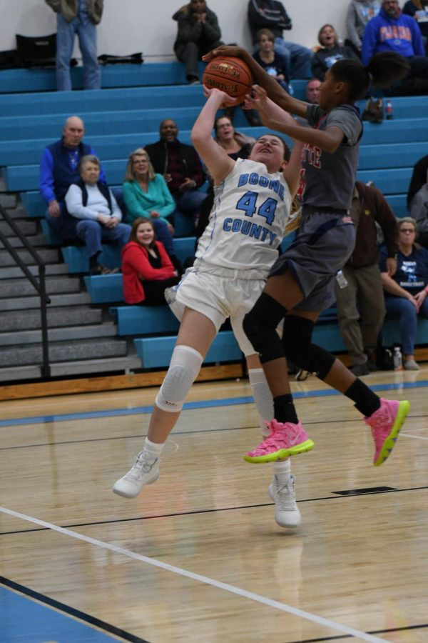 Eighth+grader+Jordan+Day+battles+for+the+ball+during+the+girls+basketball+game+against+Lafayette+on+Dec.+12.