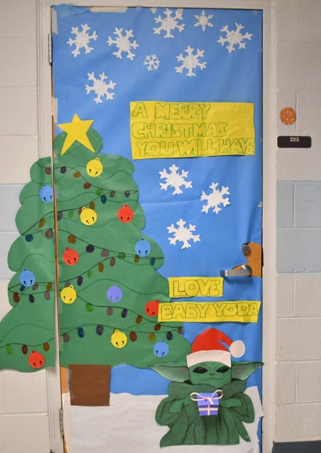 Elyse Monahan and Baby Yoda wishes everyone who passes by their room a very merry Chritsmas they will have during the Winter door contest!