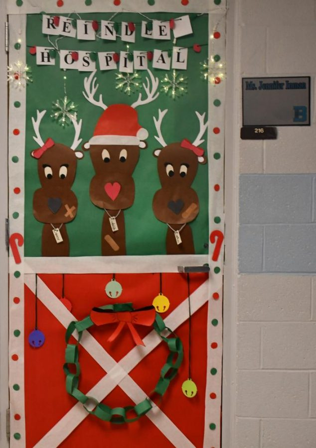 Jennifer Inman helping reindeers out at her Reindeer Hospital! Rudolph and company will stay a while at room 216 during the Winter door contest!