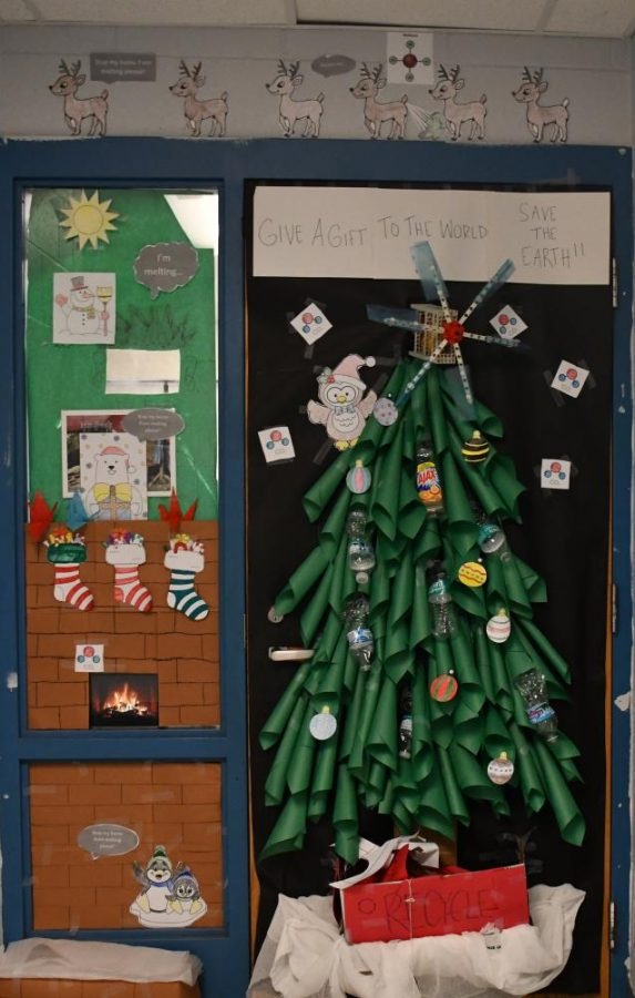 Lenny Beck went all out in his door decoration, stocks, a Christmas tree with recycled objects, and a video playing in the window of a lit-up fire under the chimney during the Winter door contest!