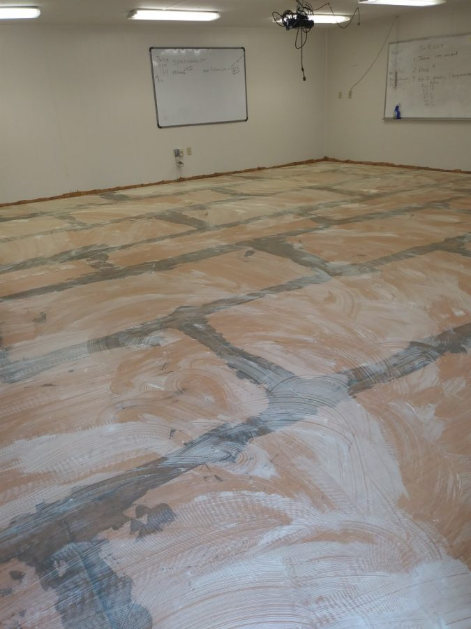 Parts of the trailers were renovated, and the floor was re-framed, along with a new subfloor (pictured) which was installed.
