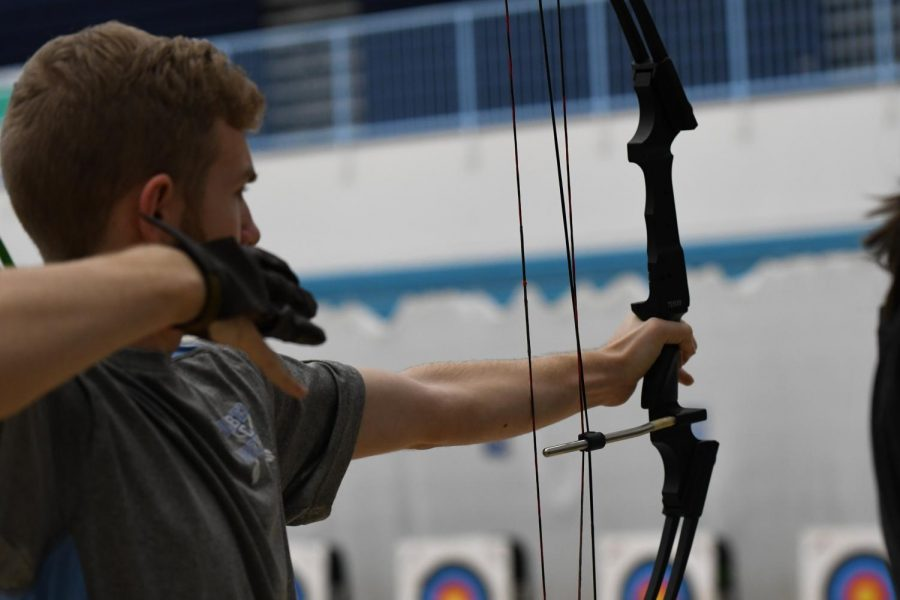 Junior Luke Smalley shoots a bow and arrow at the archery tournament at Boone County High School on Jan. 11.