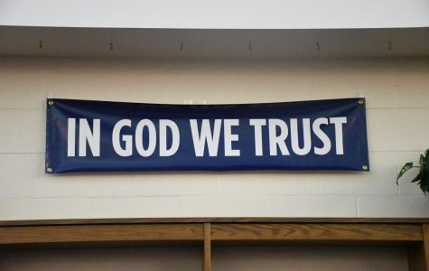 'In God We Trust' banner required by state law