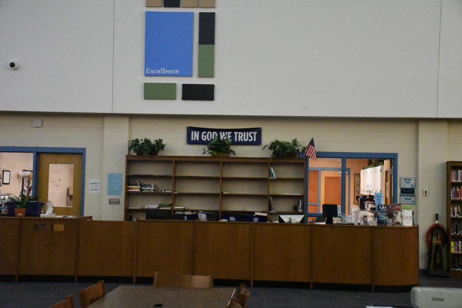 "The national motto, ""In God We Trust,"" is displayed on a banner in the school library  to comply with House Bill 46, which became a law last year with the support of every Boone County politician."