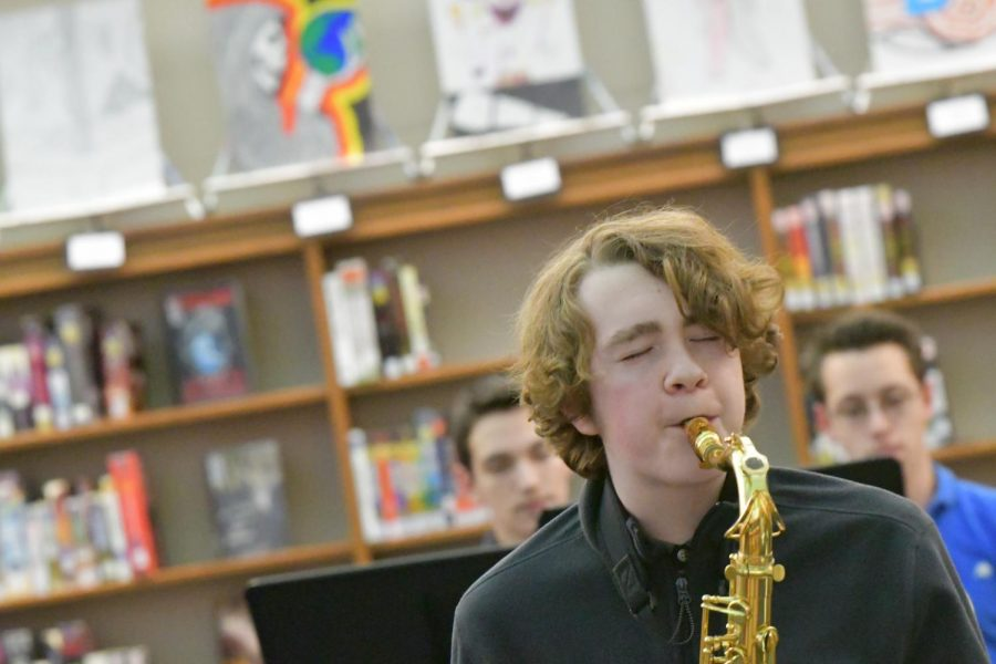Sophomore Alexander Porter plays the saxophone during the arts showcase at Boone Legacy Night on Feb. 12.