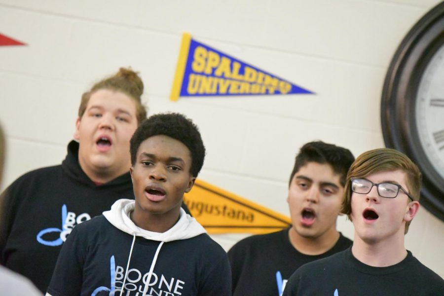 Senior Chris Mboyo and junior Alex Reay sing with the choir during the arts showcase at Boone Legacy Night on Feb. 12.