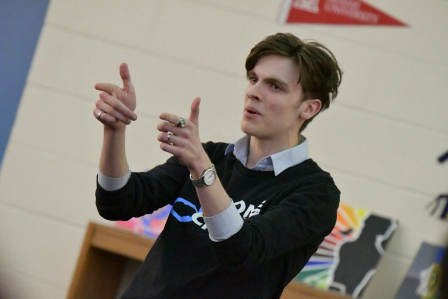 Senior Bryce Herzner performs a solo improvisation act during the arts showcase at Boone Legacy Night on Feb. 12.