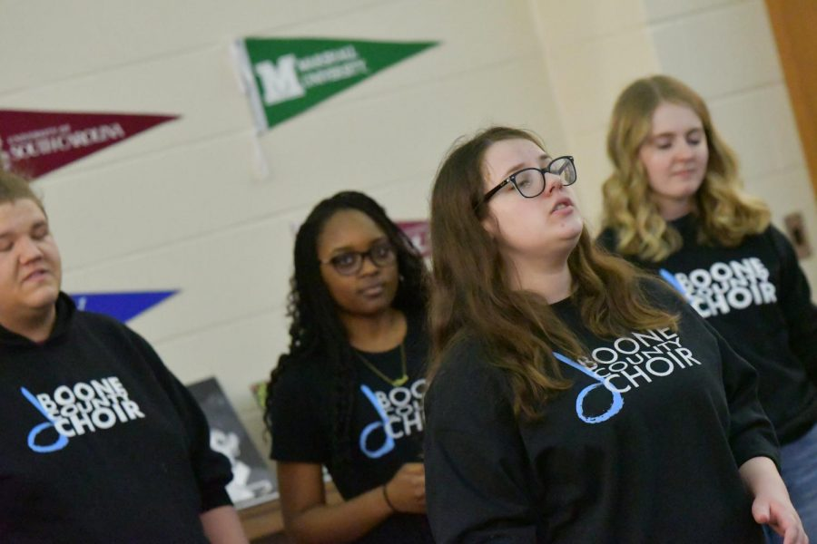 Senior Catherine Johnson signs with the choir during the arts showcase at Boone Legacy Night on Feb. 12.