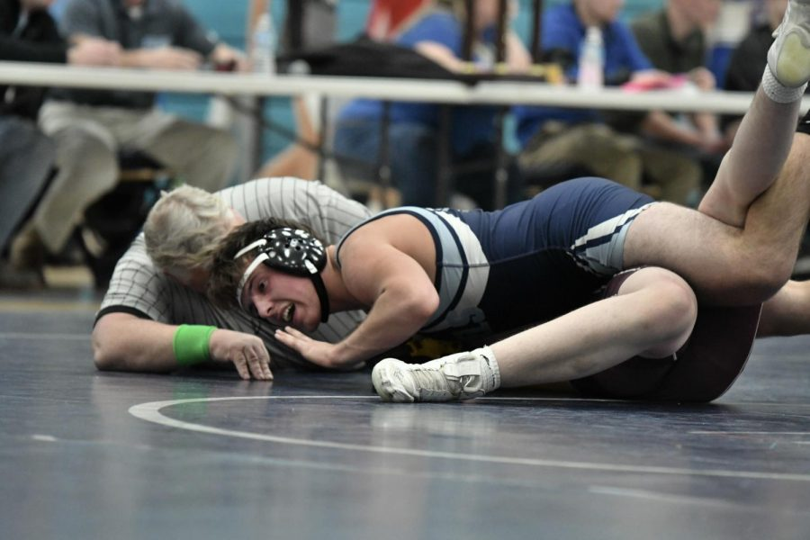 Senior Bryce Chenot puts a Cooper wrestler on his back at the county championship at Boone on Jan. 15.