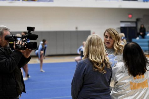 Fox19 reporter and Boone alumna Lauren Minor interviews cheer coaches Michelle Schuster (left) and Kim Grimes (right) during the winter pep rally on Feb. 14.