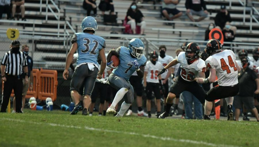 Sophomore Jeremiah Williams carries the ball during the home football game against Ryle on Sept. 11.