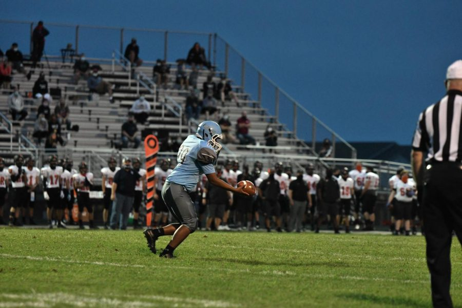 Sophomore Jesus Fabian punts during the home football game against Ryle on Sept. 11.