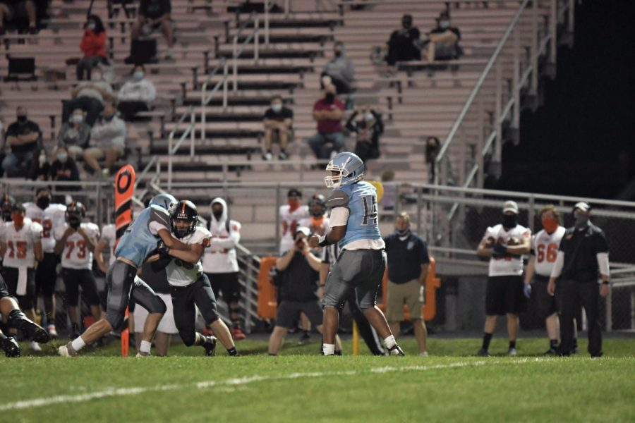 Sophomore quarterback Jamar Hocker drops back to pass during during the home football game against Ryle on Sept. 11.