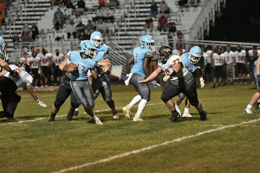 Sophomore quarterback R.J. West rushes down the field during the fourth quarter of the home football game against Ryle on Sept. 11.