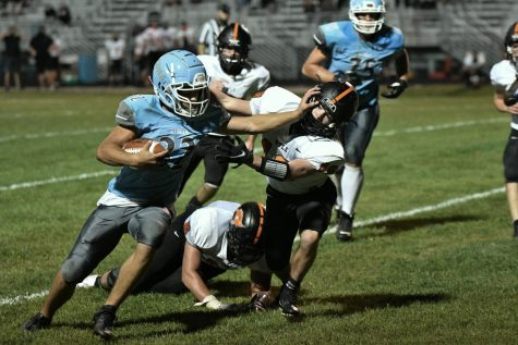 Sophomore Braden McCarty stiff arms a Ryle tackler during the fourth quarter of the home football game against Ryle on Sept. 11.