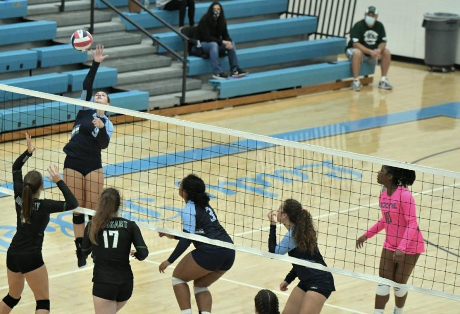 Junior Abby Gordon jumps for a kill during the Oct. 3 match at home against Bishop Brossart. Boone won the match 3-0.