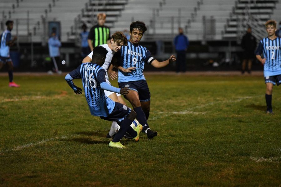 Seniors Mardoche Matumueni and Sebastian Moreno work together to steal the ball from Conner player  during Boone's home game vs Conner on Oct. 8.