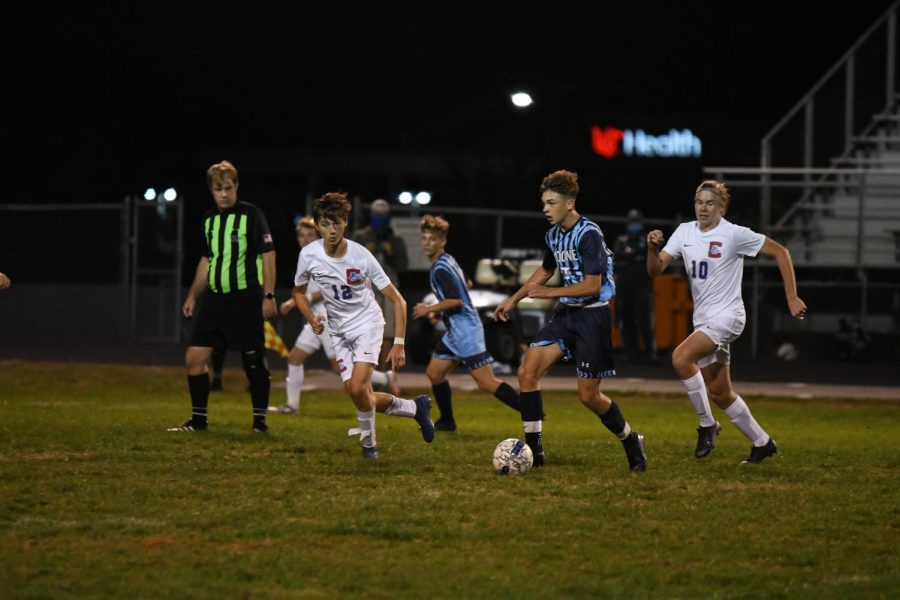 Senior Justin Jutzi dribbles down the field  during Boone's home game vs Conner on Oct. 8.