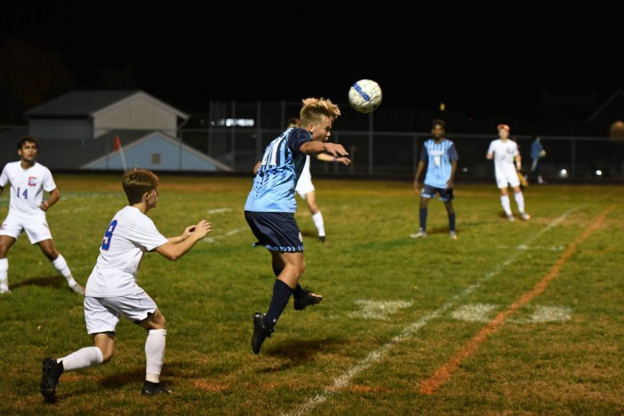 Sophomore Cole Marsh heads the ball away from Conner defender during Boone's home game vs Conner on Oct. 8.