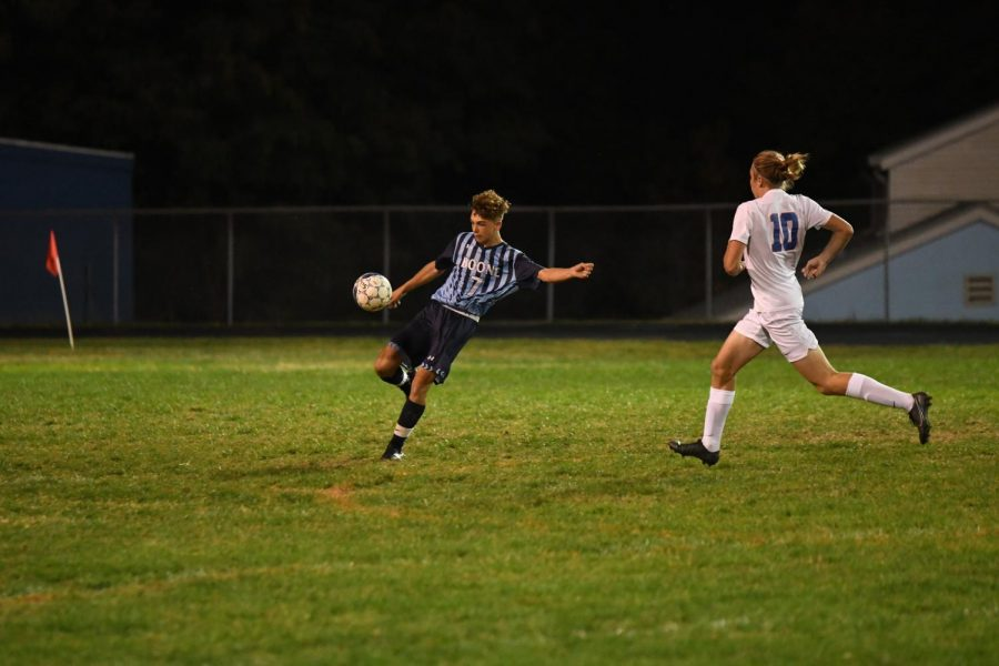 Senior Justin Jutzi kicks the ball up the field during Boone's home game vs Conner on Oct. 8.