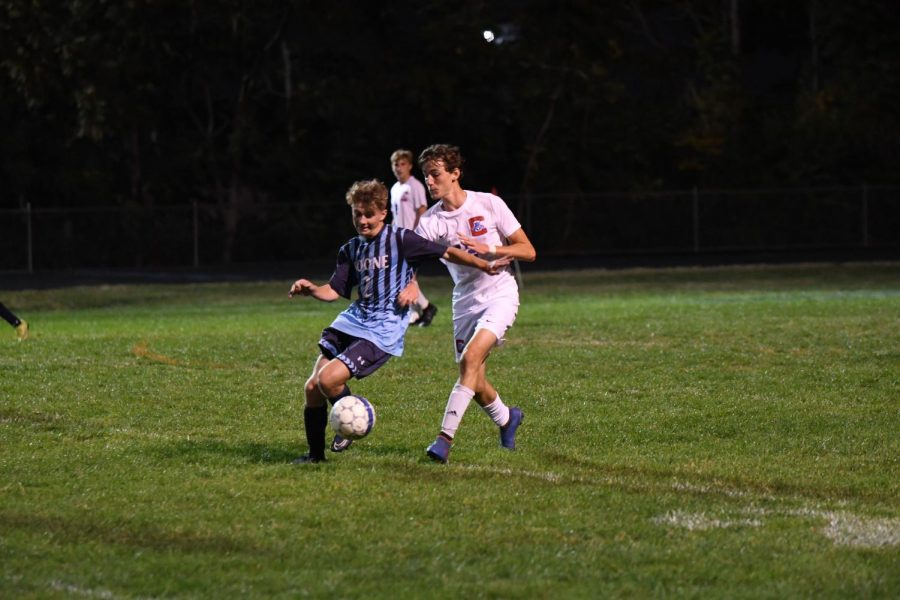 Sophomore Cole Marsh dribbles the ball up field during Boone's home game vs Conner on Oct. 8.