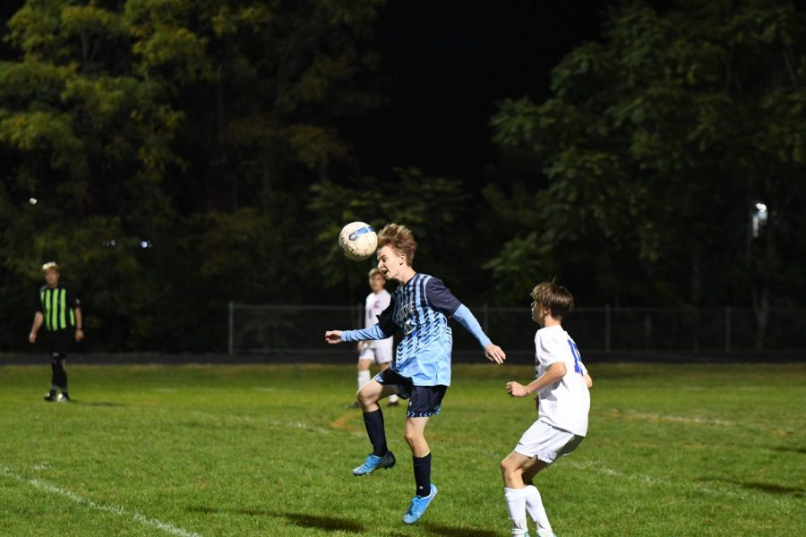 Junior John Courtney heads the ball away from Conner defender during Boone's home game vs Conner on Oct. 8.