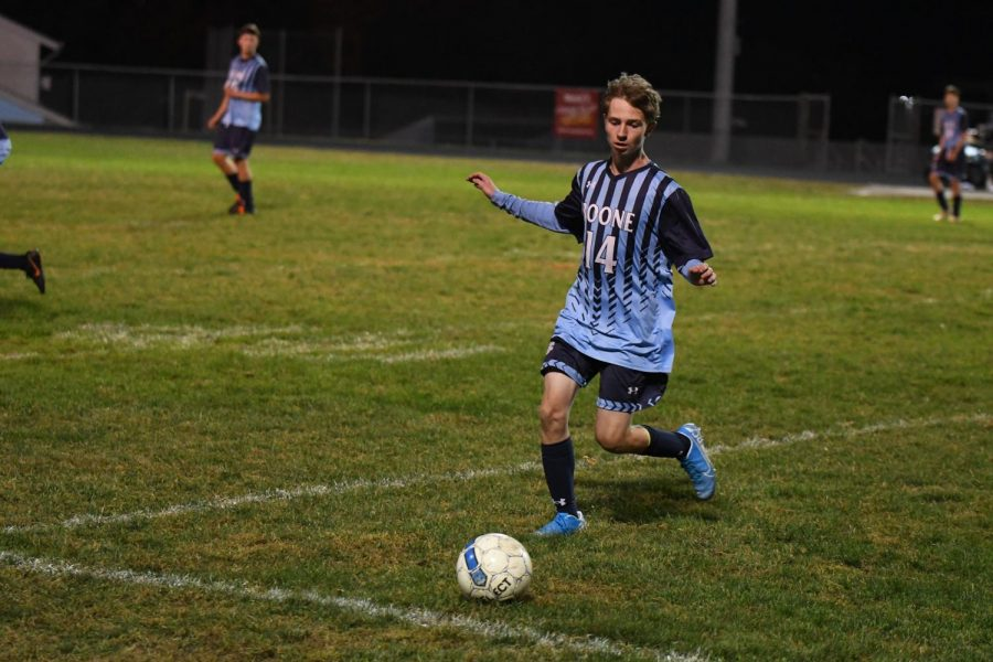 Junior John Courtney dribbles the ball during Boone's home game vs Conner on Oct. 8.