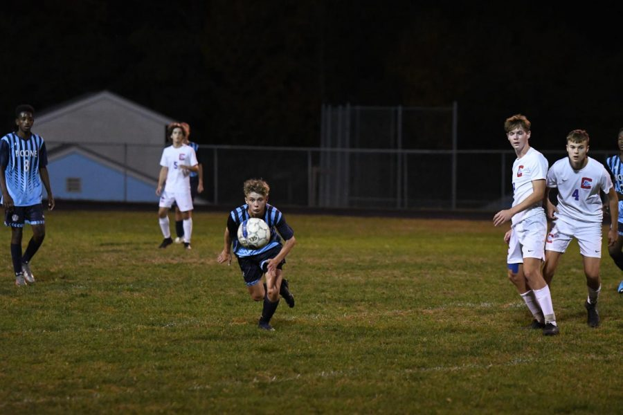 Sophomore Cole Marsh chases after the ball during Boone's home game vs Conner on Oct. 8.