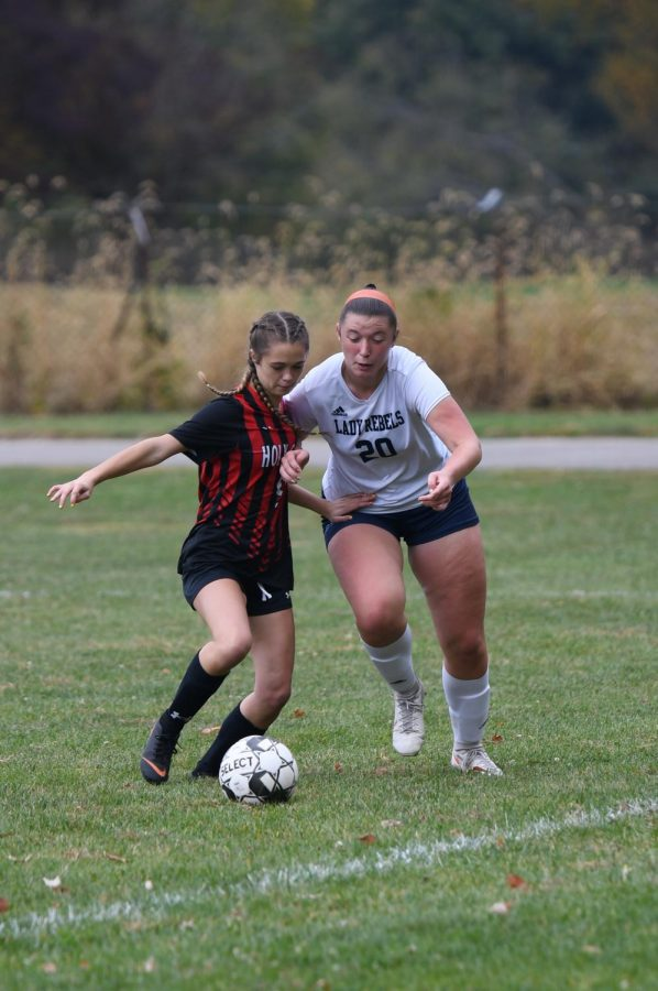 Senior Savannah Briedis battles for the ball during Boone County's 2-1 win over Holy Cross on Oct. 10 in Covington.
