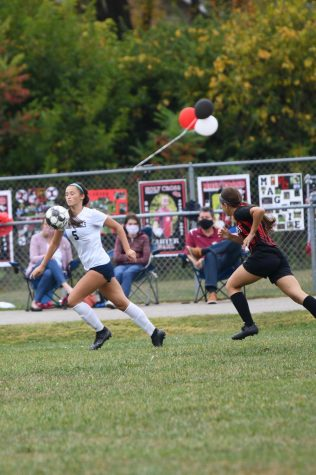 Senior Raygen Black drives towards the goal during Boone County